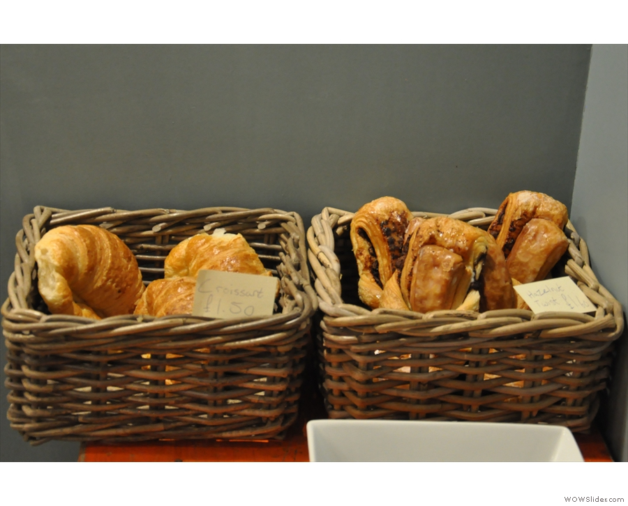 There are also some croissants and other pastries to the right of the counter.
