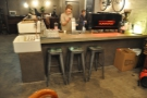 The last of the downstairs seating are these three stools at the end of the counter.