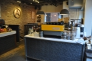 The espresso machines have a counter of their own to your right, with the seating beyond.