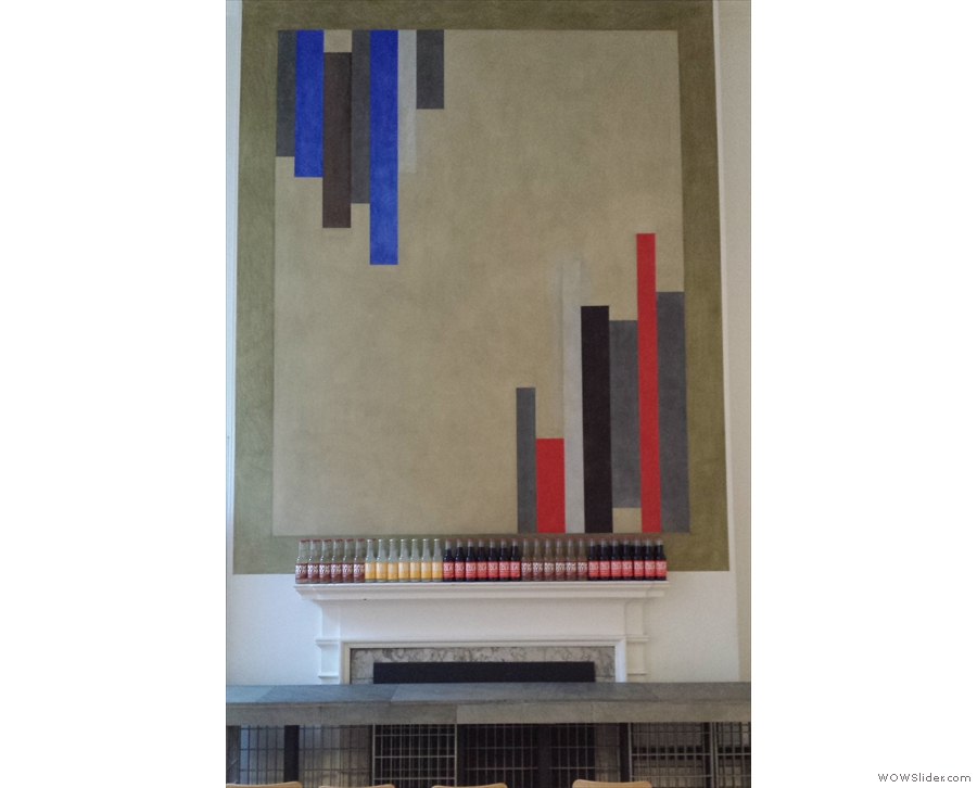 There is another fireplace, with more abstract art above it...