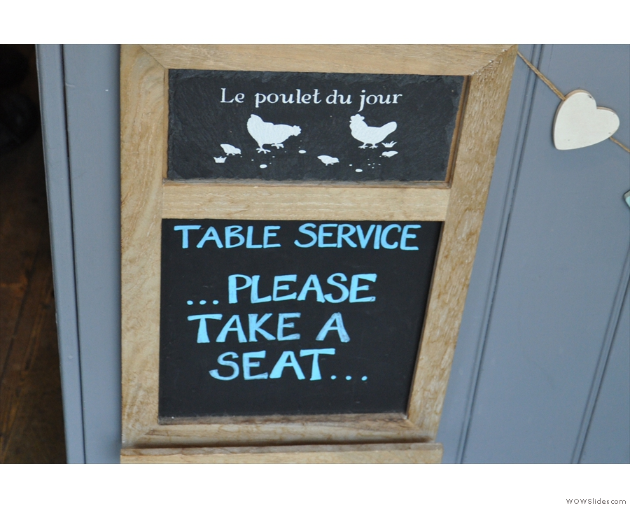 Table service! Rare words to warm anyone's heart! Take a seat, it says...