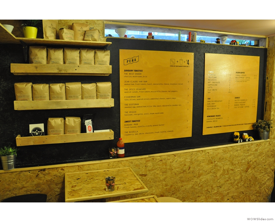 The main menu is on the front wall, next to the retail shelf.