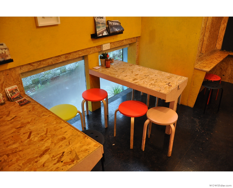If you like, you can sit at these two tables by the windows...