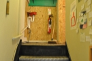Step inside and all becomes clear(ish): there are stairs leading up to the top floor...