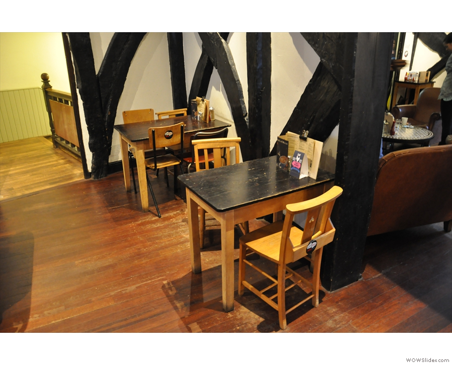 Some of the varied seating available: tables against the wall as you come in...