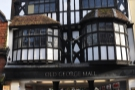 It includes this timber-framed, double-bay building over the entrance to the George Mall