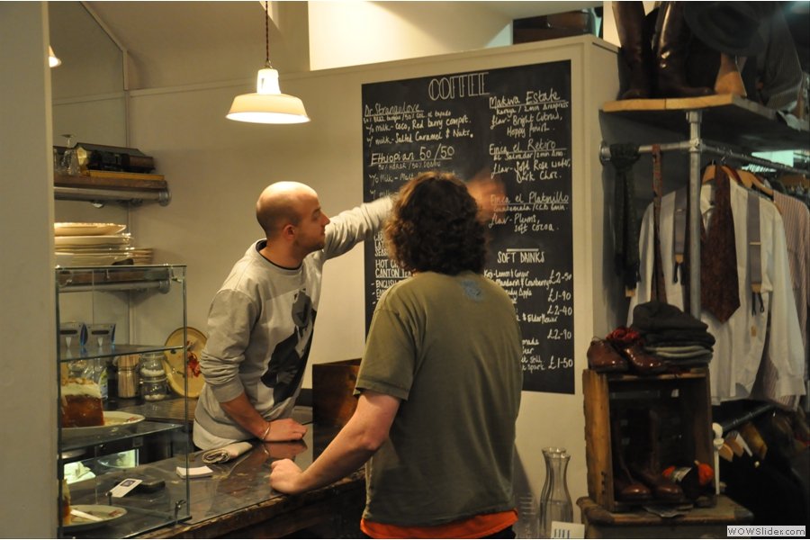 Kit comes out from his hiding place to explain the menu to Andrew. Or to wipe it off the blackboard. Not sure which...