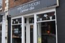 Harvest Moon Espresso Bar it says above the door. Moon Beer & Coffee says the window.