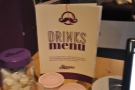 You can find the drinks menu on the table.
