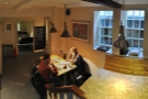 A panoramic view from the landing. Check out the bar at the bottom of the stairs.