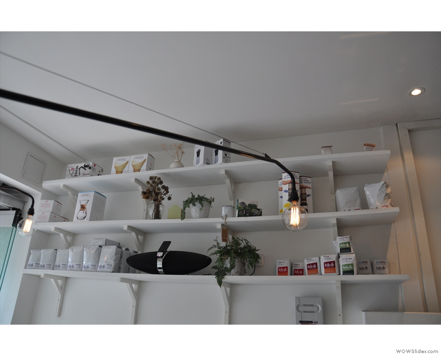 This row of shelves sits above the bench on the left-hand wall.