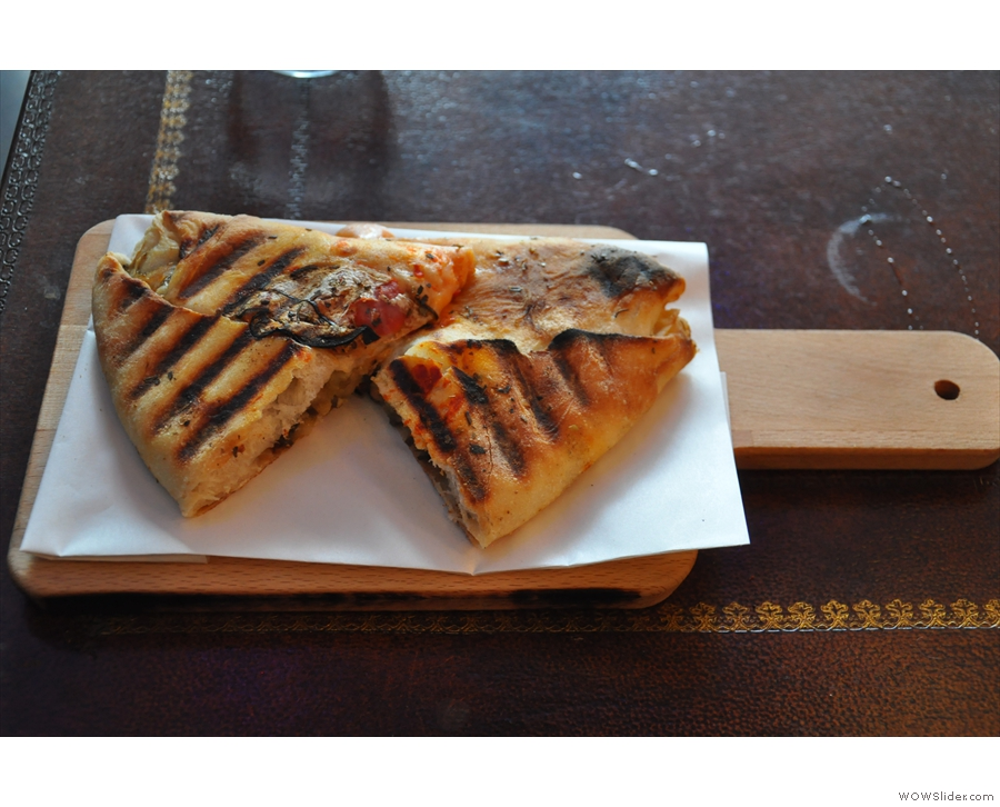 I settled for the Calzone Parmigiano, which came on its own wooden paddle.