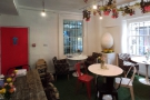 A panoramic view of the lovely downstairs at Daisy Green, even smaller than the upstairs.