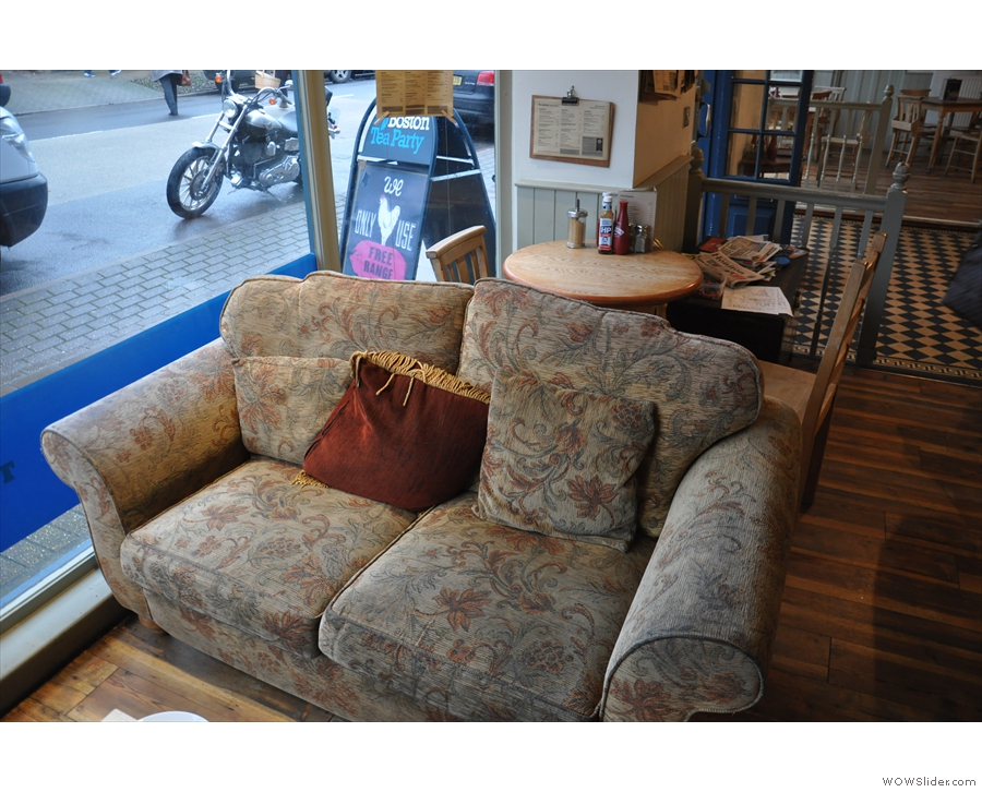 One of the two very comfortable-looking sofas, with a small table squeezed in behind!