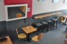 A view of the bar opposite the counter. The dash of red brightens the place up.