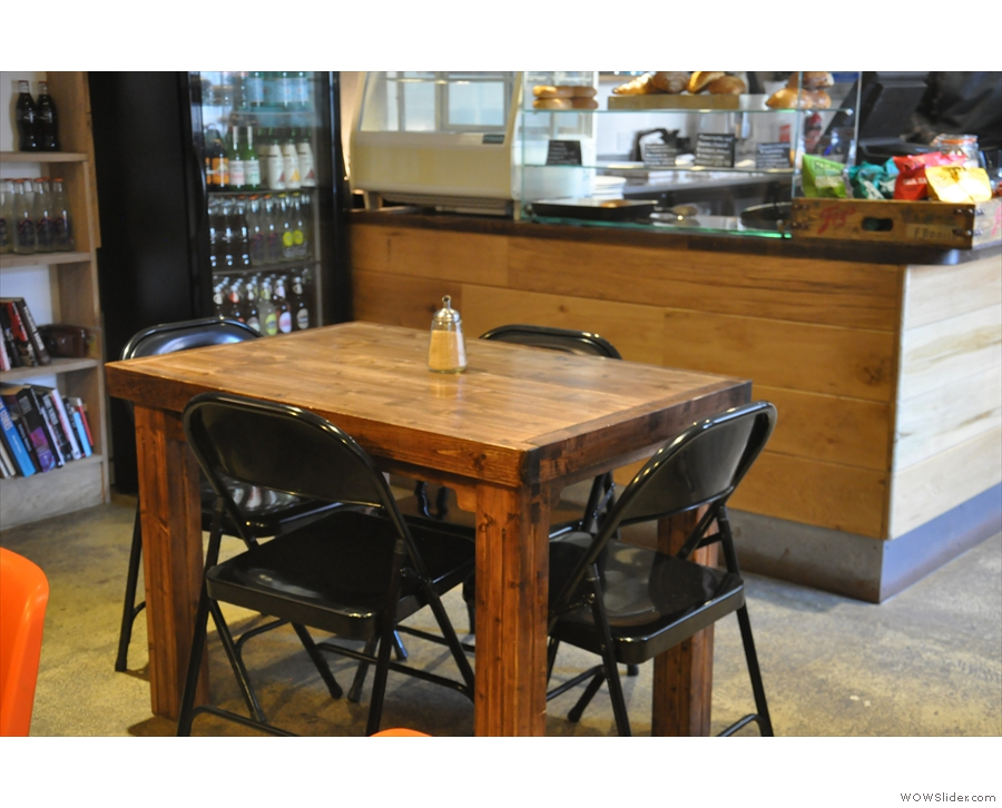This four-person table sits in glorious isolation between the counter and the bench.