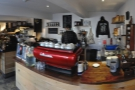 Going inside, the counter is immediately to your right, the bright red La Marzocco to the fore.