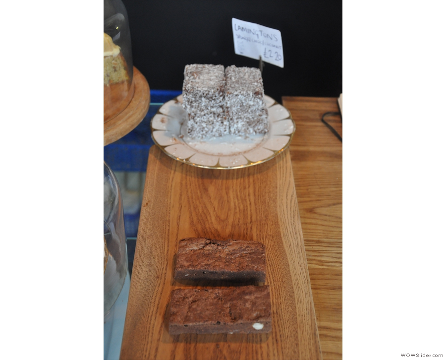 Chocolate brownies and slightly out-of-focus lamingtons.