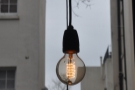Although the windows make it nice and bright, bare light bulbs abound.