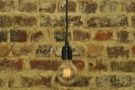 You can't beat a good light bulb. Or a bare brick wall.