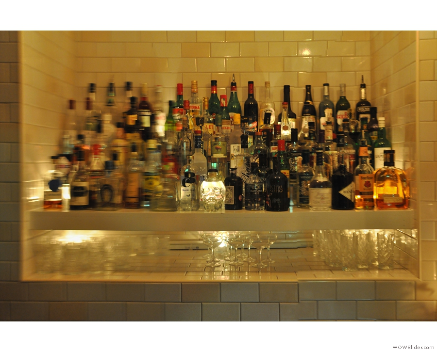 ... revealing a very comprehensively stocked bar...