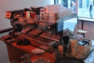 In case you missed it, the La Marzocco is at the front of the counter, opposite the window.