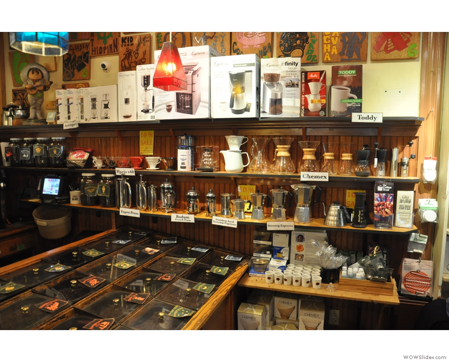 There are rows and rows of coffee kit on the wall.
