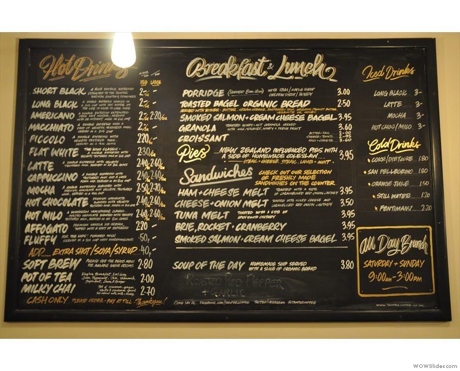 The menu is on a blackboard on the walll opposite the counter...