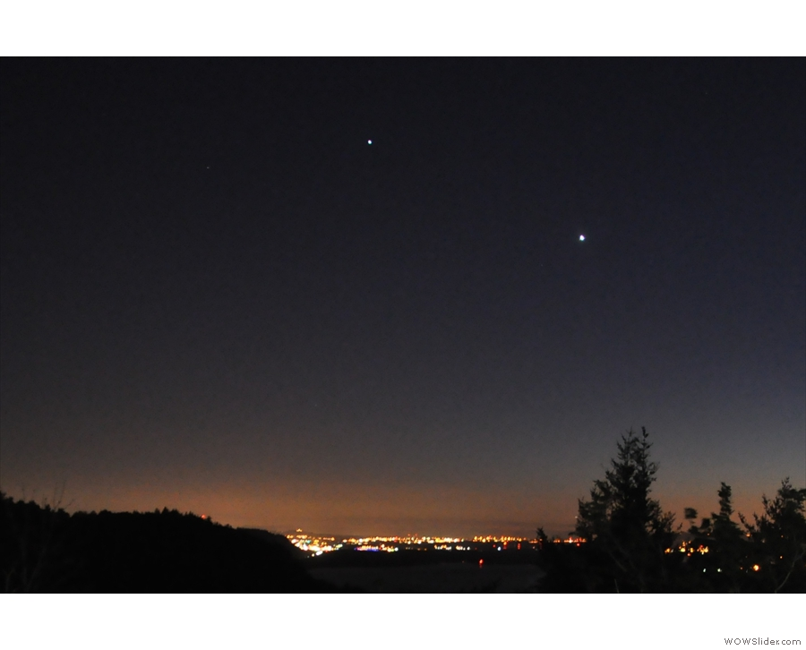 Both Venus and Jupiter were prominent on the horizon above the city's glow.