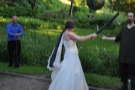 Brian seems unimpressed with his bride's piñata hitting skills! Careful, she's still got the bat!