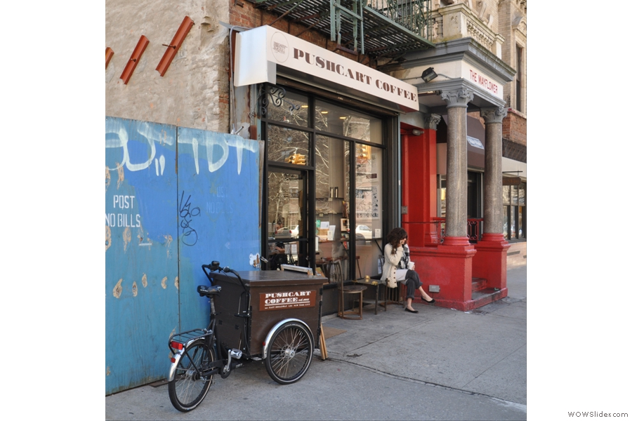 On the corner of Clinton and East Broadway, you'll find Pushcart Coffee, its location more than adequately sign-posted by the three-wheeled cart outside