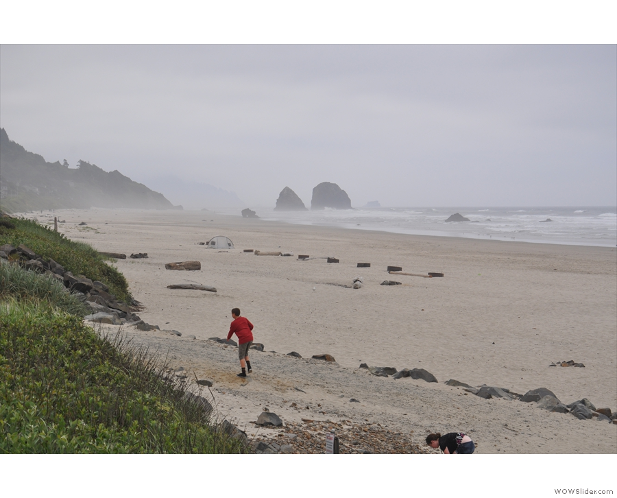 The beach was bounded by rocky outcroppings to the south...