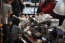 Barista at work: here it comes. A good barista always watches the extraction, just to ensure all is going well!