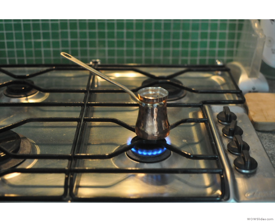 First place your cezve on a small gas burner over a low heat.