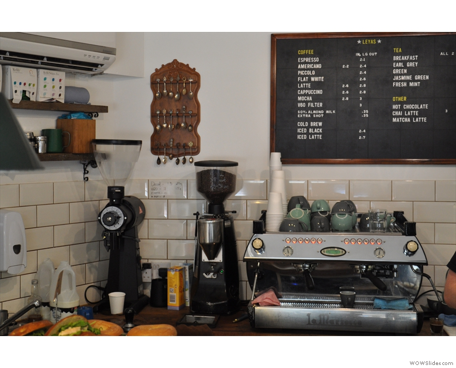 The coffee corner, with the menu on the wall behind the espresso machine.
