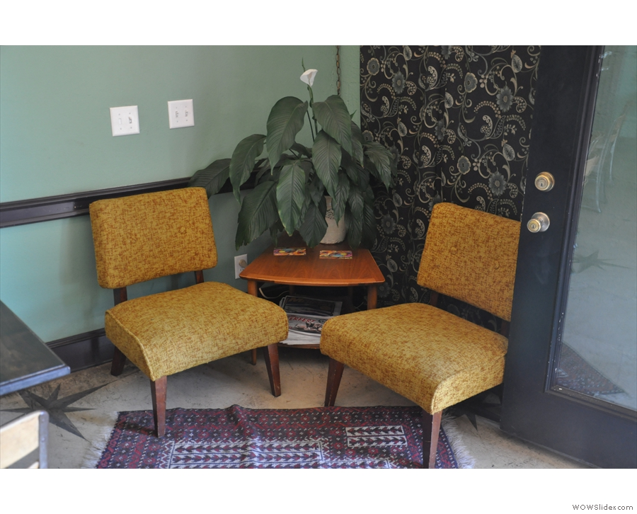 There's a variety of seating, including this pair of armchairs to the right of the door.