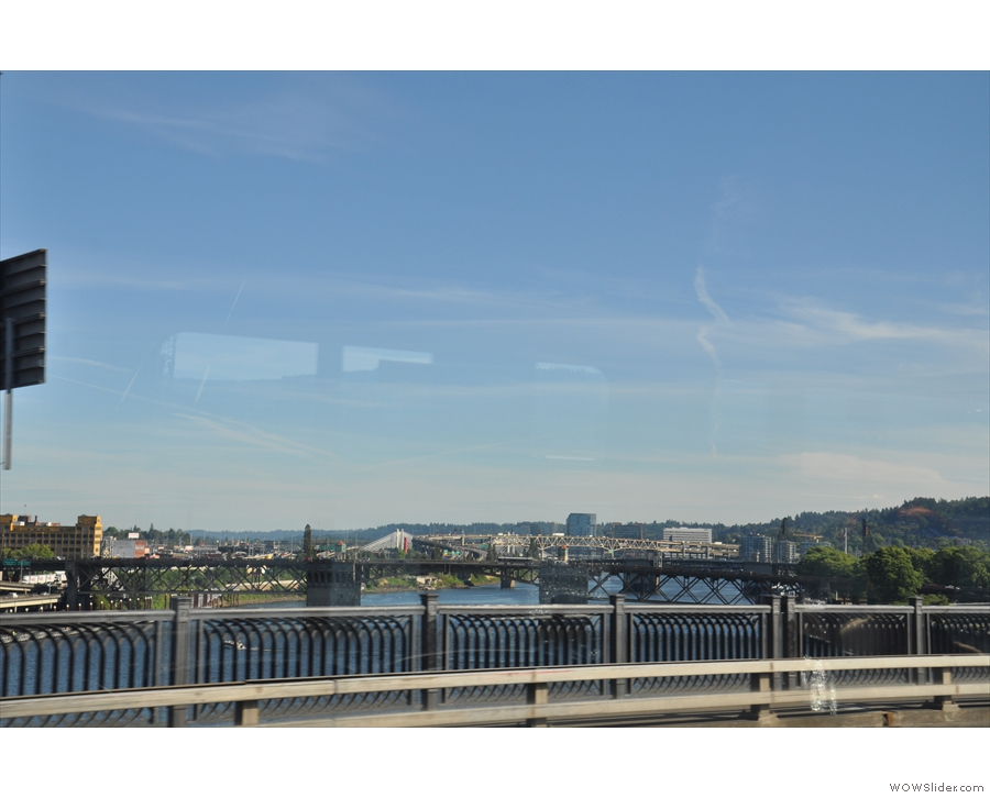 Here I am, crossing the Hawthorne Lift Bridge, looking downriver (north), Portland to my left.
