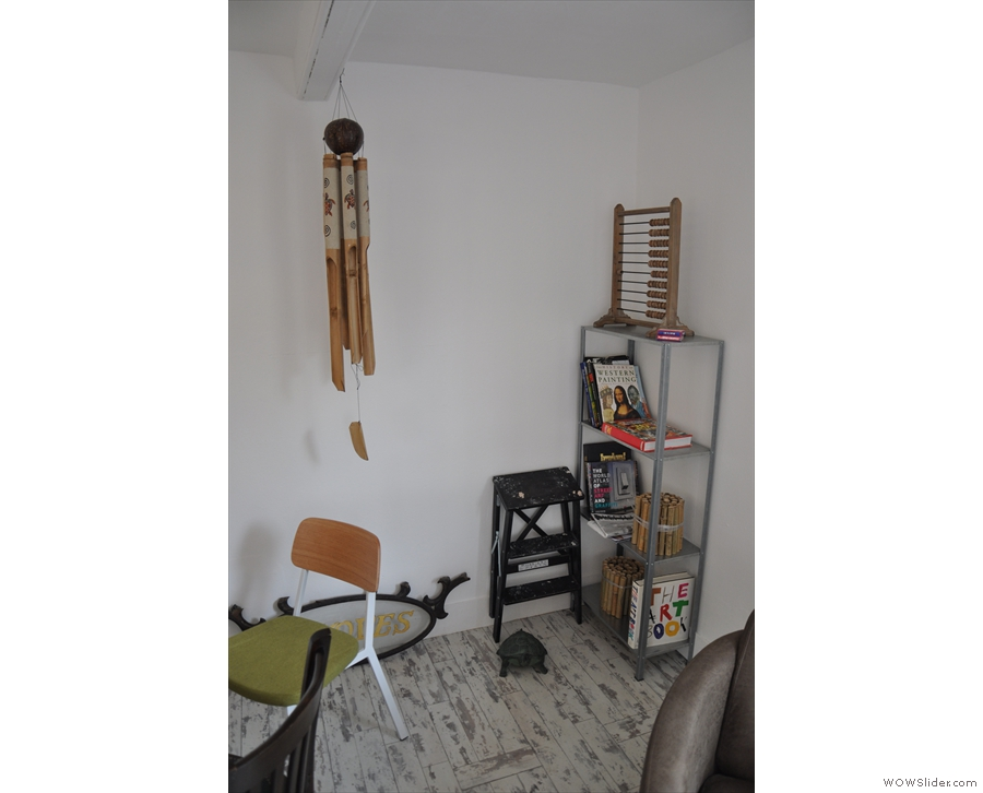 Then there's a wind chime, bookshelf and, in case the till breaks, a back-up abacus!
