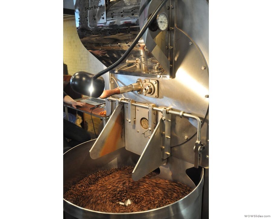 The previous roast is still cooling as the new one gets underway.