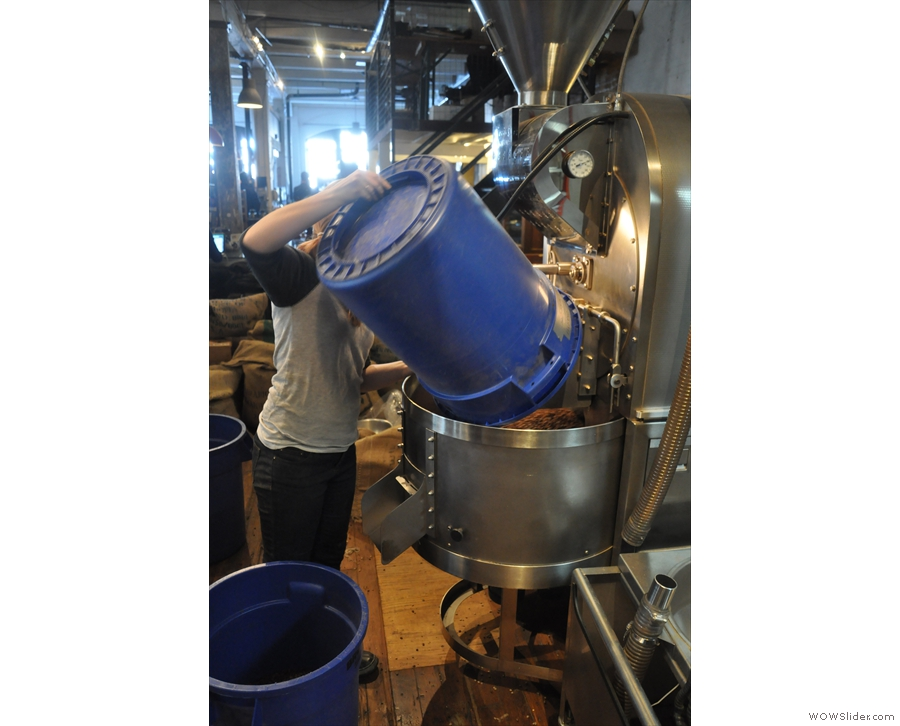 But what's this? Amy, the roaster, is pouring another bucket of beans into the cooling pan!