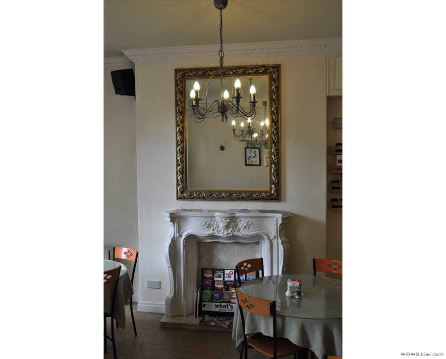 I was particularly fond of the mirror above the fireplace. And of the fireplace itself...