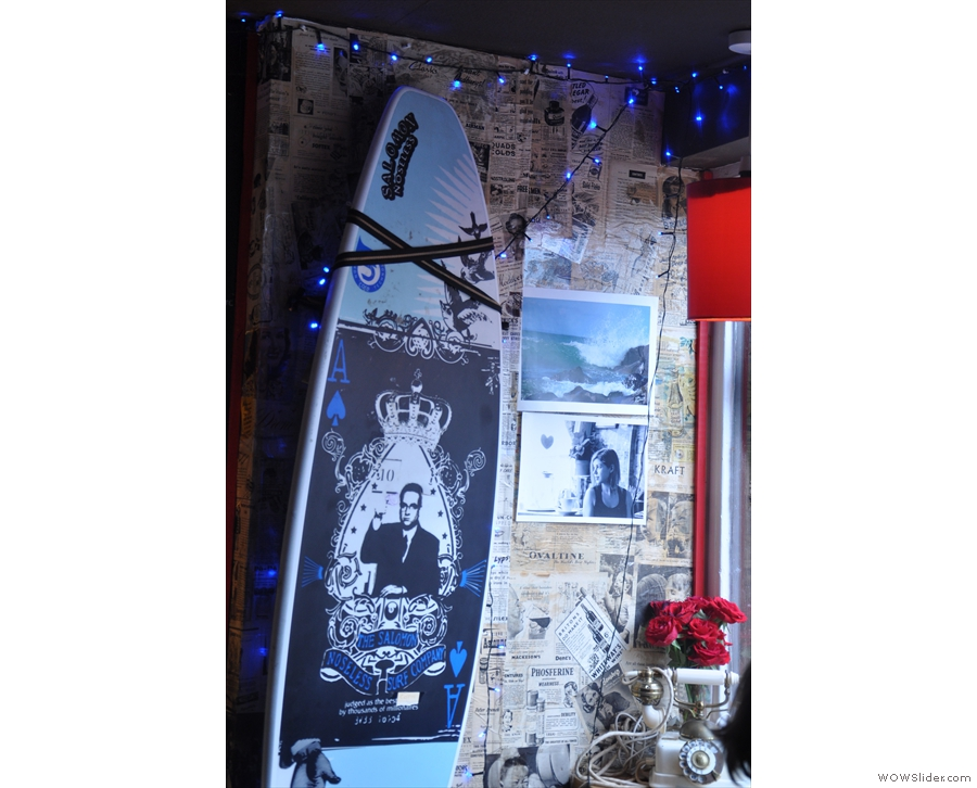 There's also this highly-decorated surf board strapped to the wall.