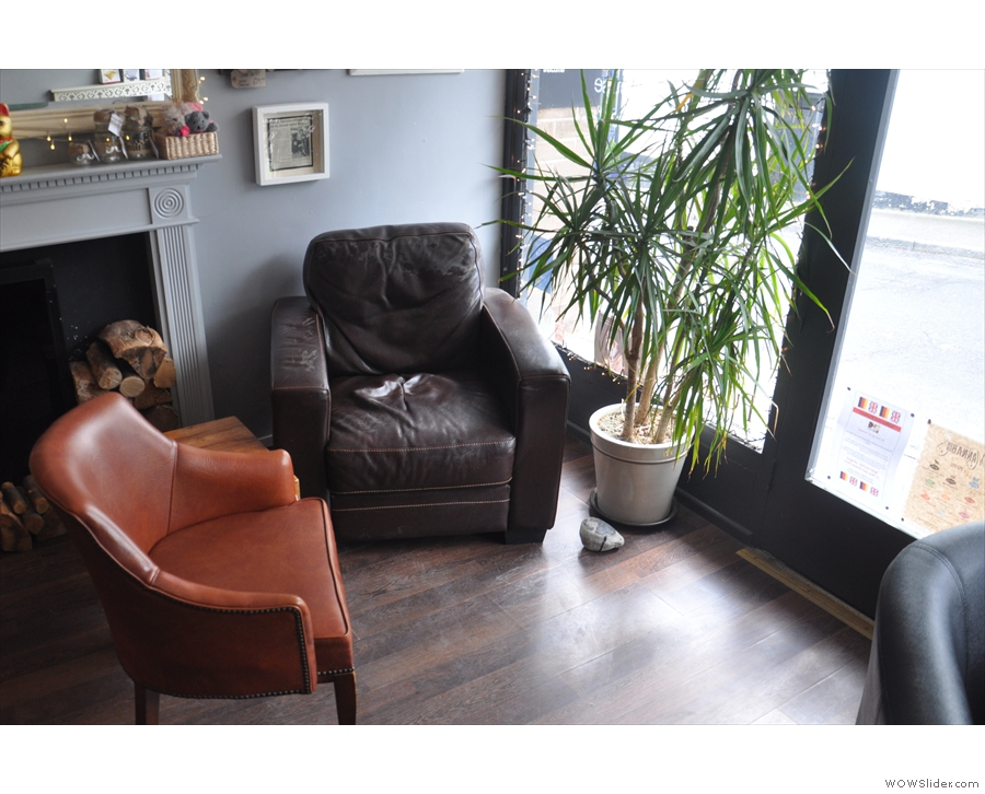 If you want to sit in the window, grab these two armchairs to the right of the door.