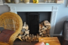 Neatly-stcked piles of wood suggest that this is a real, working fireplace.
