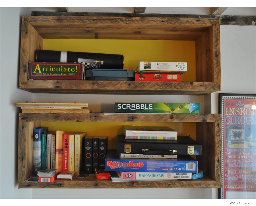 There are lots of small touches, like these shelves of books and games.