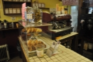 Meanwhile, the espresso machine hides behind the cake stand at the other end.