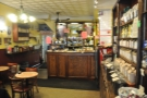 The counter is all the way at the back, with a little takeaway shelf on the left.