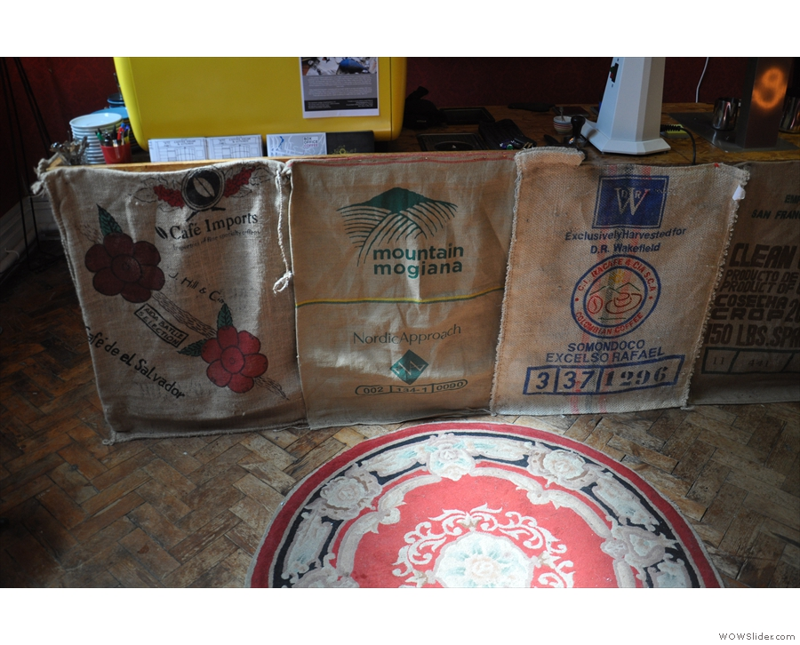 The counter itself is faced with these old coffee sacks...