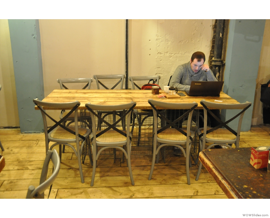 The tables come in a variety of sizes, such as this eight-seater on the right...