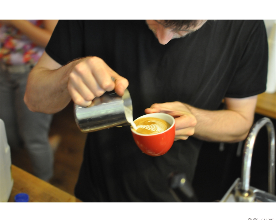 Here's Aaran making a flat white (for another customer) and practicing his latte art...
